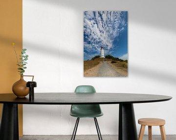 Schapenwolken boven de vuurtoren op het eiland Hiddensee van GH Foto & Artdesign