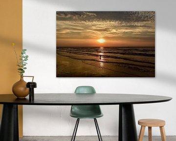 Ondergaande zon aan het Scheveningse strand