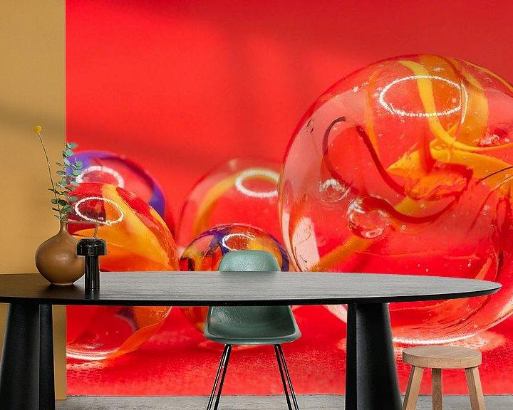 Sfeerimpressie behang: Close up van glazen knikkers met gekleurde rook in de bollen van Henk Hulshof