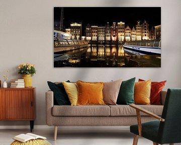 Die Grachtenhäuser am Damrak in Amsterdam, Niederlande von Be More Outdoor