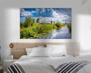 Molens langs de waterkant bij Kinderdijk, Nederland van Rietje Bulthuis