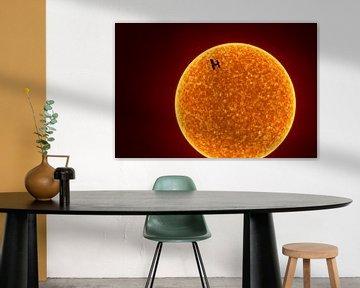La station spatiale internationale devant le soleil sur Markus Gann