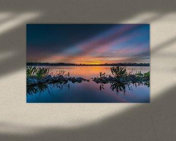Kleurrijke lucht tijdens zonsondergang van Marcel Kerdijk
