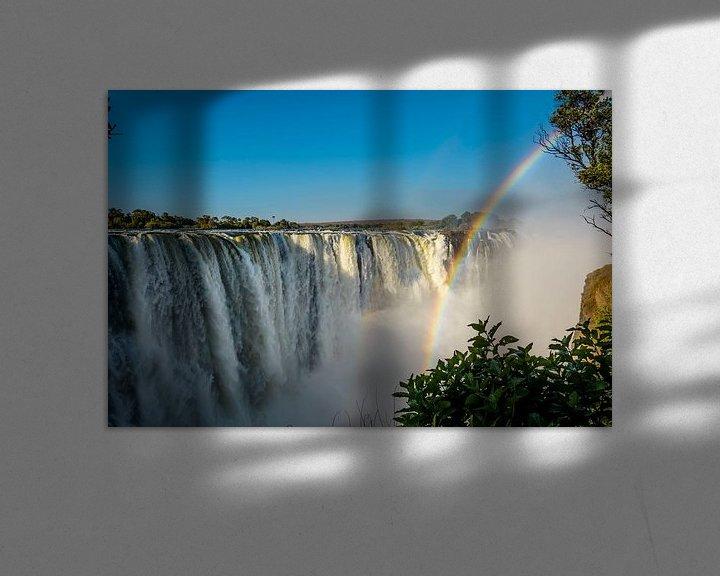 Sfeerimpressie: Regenboog over de Victoria waterval van Theo Molenaar