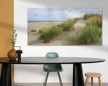 Strand, wolken en de zee van Dirk van Egmond