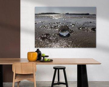 Glaskolben am Strand von Fotografiemetangie