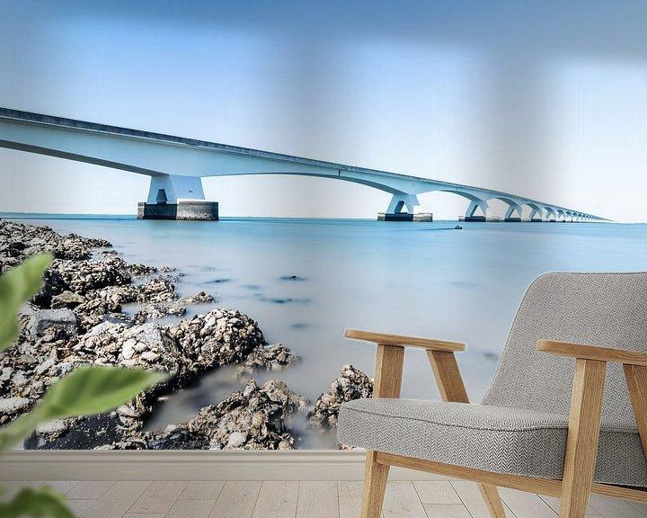 Sfeerimpressie behang: De Zeelandbrug in grijs en blauw van Josephine Huibregtse
