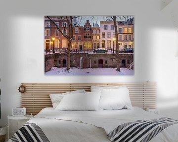 Winterse avondsfeer langs de Nieuwgracht, Utrecht van André Russcher