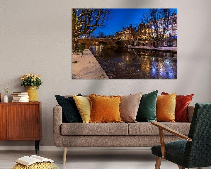 Sfeerimpressie: Bevroren Oudegracht in Utrecht. van André Russcher