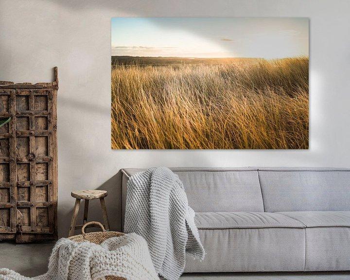 Sfeerimpressie: Zonsopkomst boven de Nederlandse duinen aan de Noordzee kust van Fotografiecor .nl