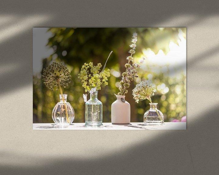 Sfeerimpressie: Various pots with flowers and a honey bee van Boy  Driessen
