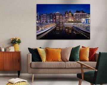 Het Damrak in Amsterdam - Nederland van Roy Poots