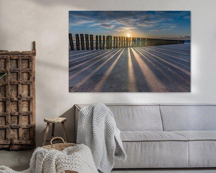 Sfeerimpressie: Zonsondergang met Golfbrekers strand  Burgh-Haamstede van Jan Poppe