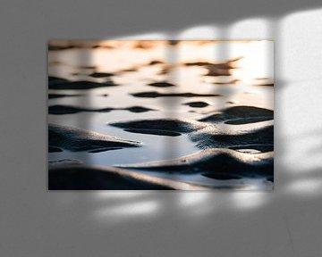 Zonsondergang over de teruggetrokken zee van mitevisuals