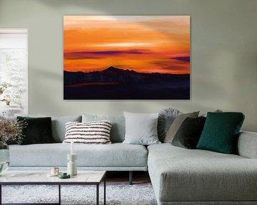 Landschap met heuvels en bomen bij zonsondergang met een hemel in oranje kleuren