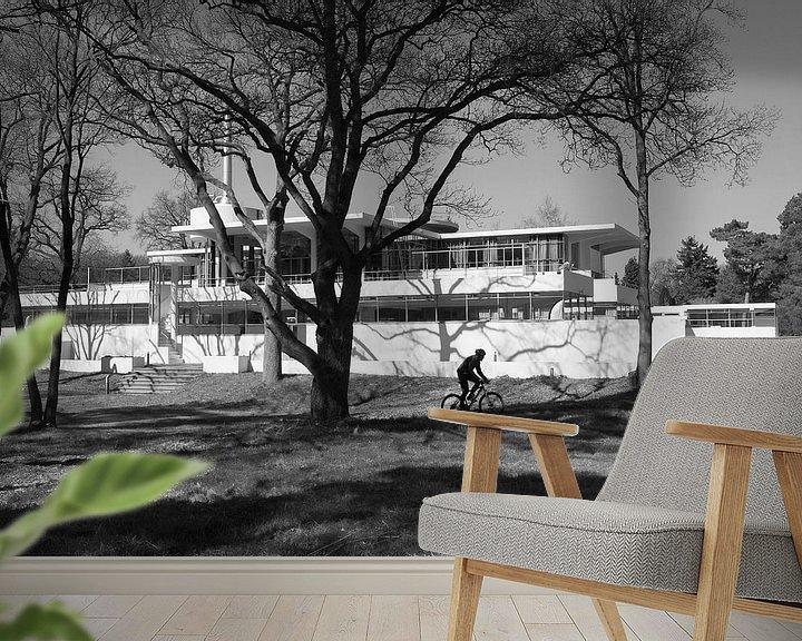 Sfeerimpressie behang: de eenzame fietser bij sanatorium Zonnestraal van Peter de Ruig