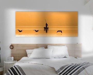 Visser bij zonsopkomst van Antwan Janssen