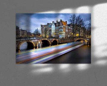 Rondvaartboten door Amsterdam van Roy Poots