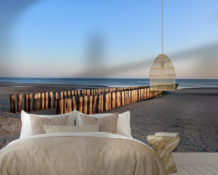 Sfeerimpressie behang: Paalhoofden op het strand van Westenschouwen van bart hartman