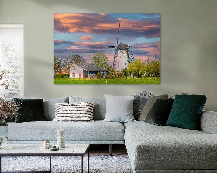 Sfeerimpressie: Windmolen in Avondrood. van Brian Morgan