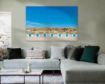 7 strandhuisjes in rij op het eiland Texel.