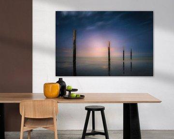 Poles on the beach van Wim van D