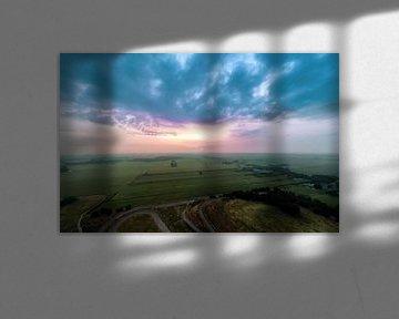 Sunset and a moody sky van Stefano Scoop