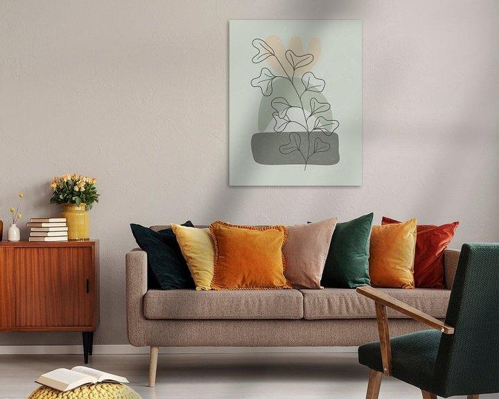 Sfeerimpressie: Minimalistisch landschap met een plant met grote bladeren van Tanja Udelhofen