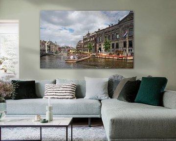 Het Damrak in Amsterdam van Ivo de Rooij