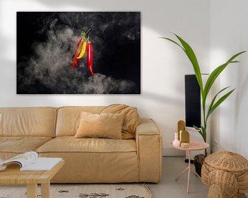 Hete pepers met rook tegen zwarte achtergrond van Wim Stolwerk
