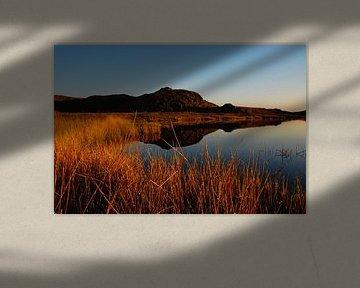Zonsondergang over meer van Marijn Goud