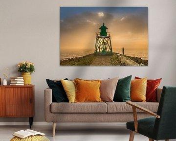 Coucher de soleil brumeux au phare de Stavoren