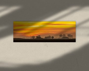 Groningse skyline bij zonsondergang van Jurjen Veerman