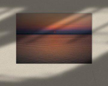 Sunset behind Copenhagen van Leon van Voornveld
